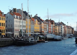 Boats in Nyhavn Harbor in Copenhagen, Denmark.