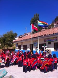 Singing the Peruvian national anthem outside the school