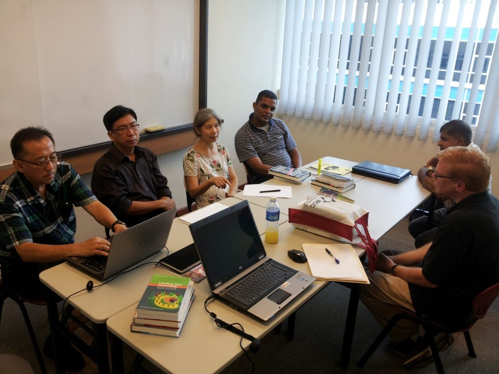 Rev. Gary MacDonald (far right) leads D. Min. students during the first day of classes at Trinity Theological College July 22.  Pictured, from left: Michael Moey (Malaysia), Tahir Wjdjaja (Indonesia), Grace Toh (Singapore), Manoj Thomas (Canada), and Paul Bala (Singapore). (Photo by T. Rasberry)