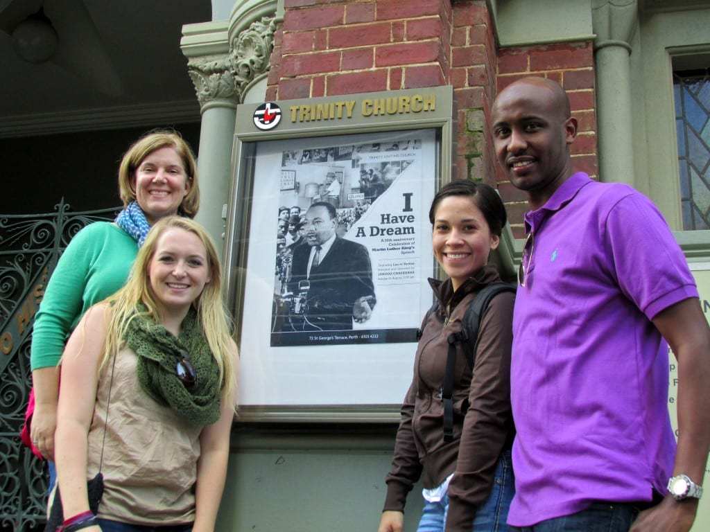 Students who participated in SMU's Civil Rights Pilgrimage beside a photo of the Rev. Dr. Martin Luther King in Perth.