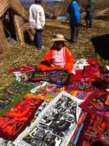 Aymara woman selling textiles on the Island of Uros