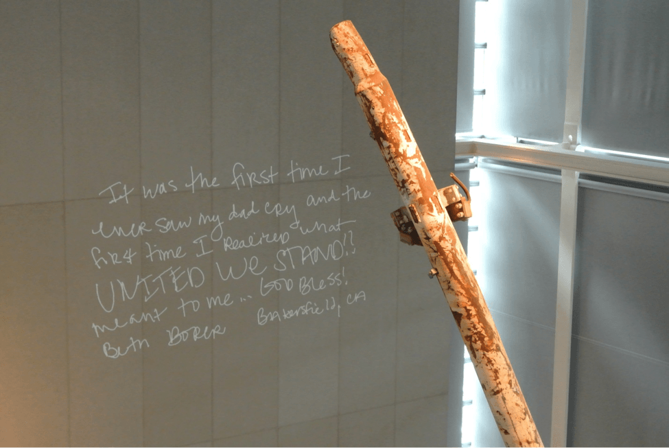 A piece of the Twin Towers post-9/11. On the wall behind it, the Newseum has a display of notes about people's experiences on 9/11. It was a very moving display.