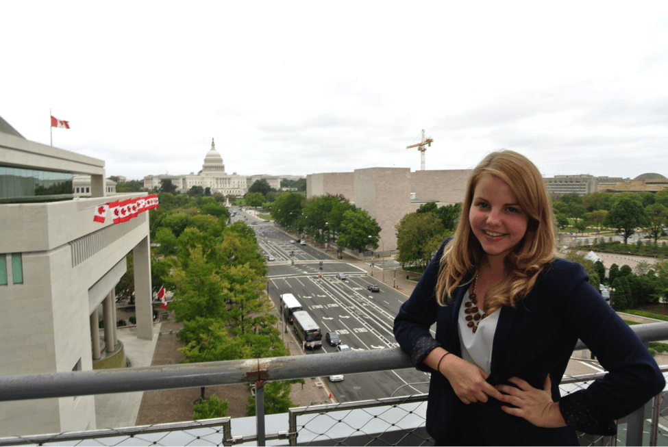 On the sixth floor of the Newseum, with a view of the Capitol.