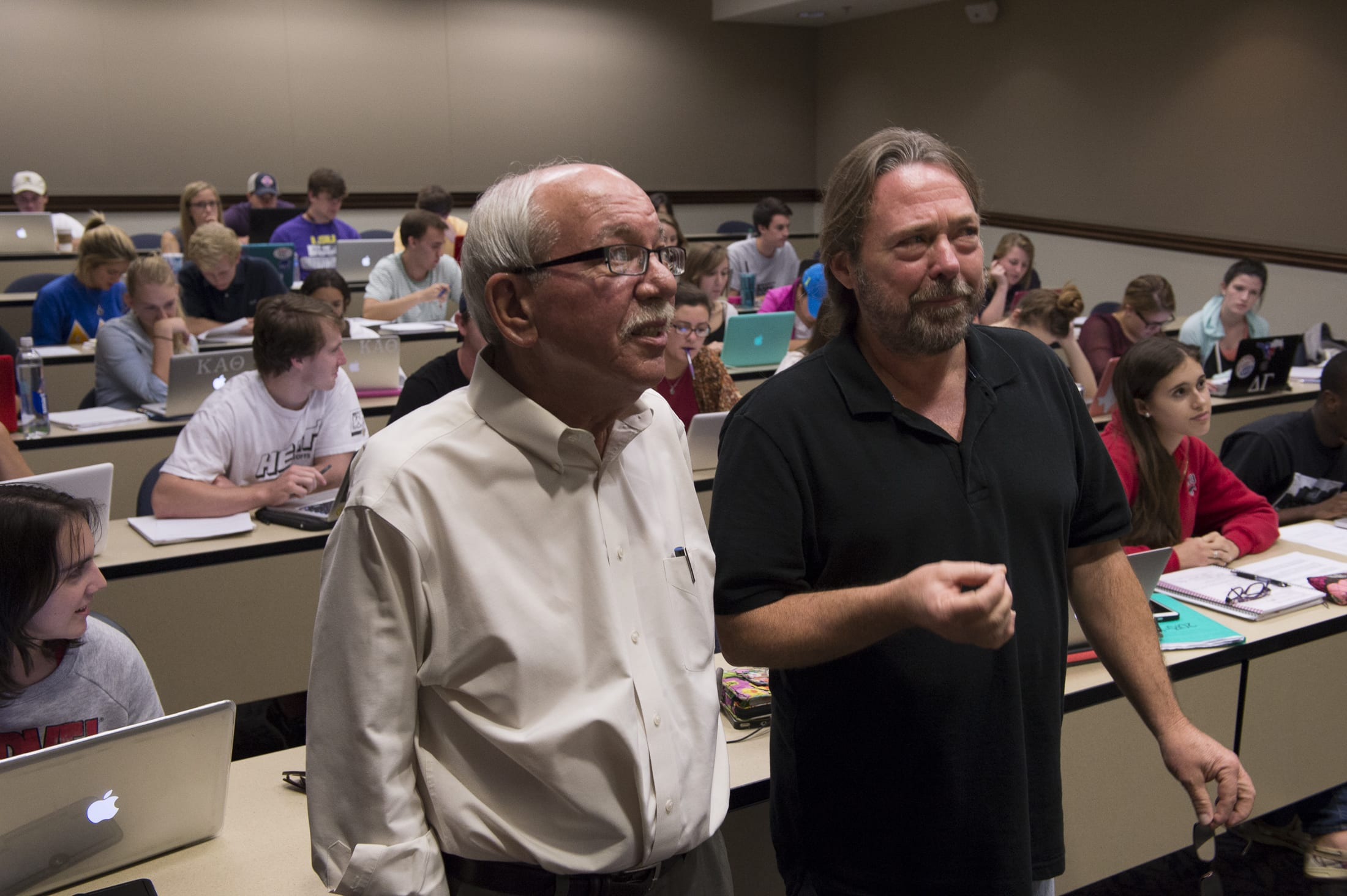 "Professors Dennis Simon (left) and Tom Stone with students in the class ""John F. Kennedy: His Life, His Times and His Legend."""