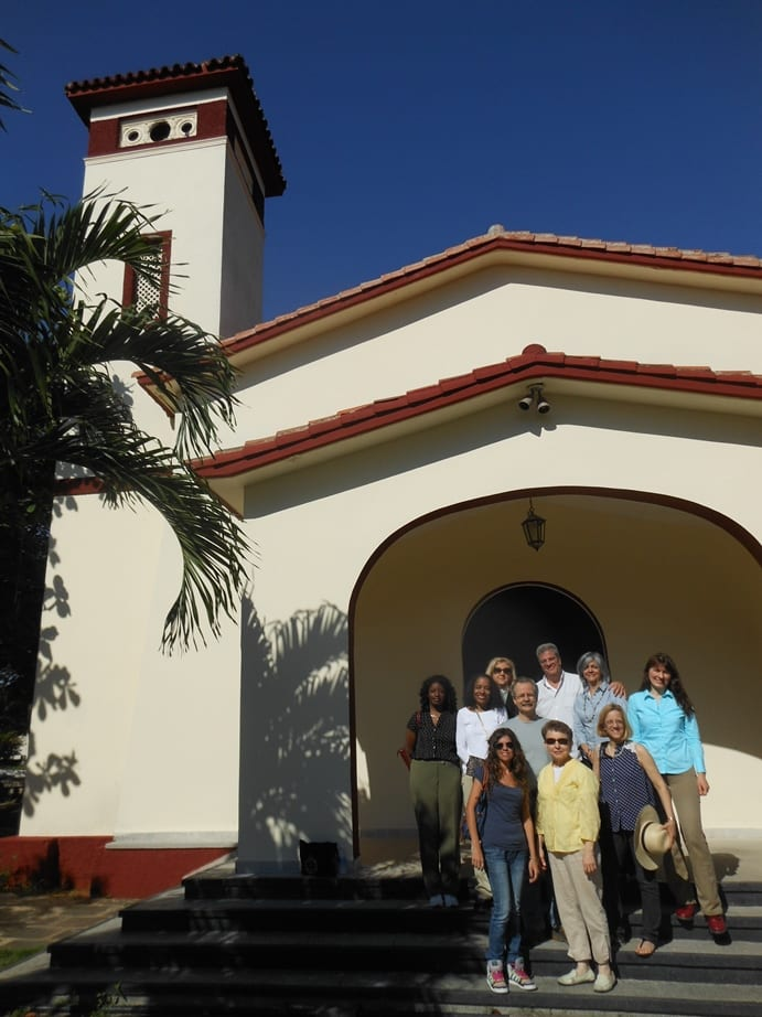 In front of the chapel at Matanzas Evangelical Theological Seminary  (from left, back row) Jeanne Stevenson-Moessner, Carlos Cardoza-Orlandi, Lizzie Oquendo; (second row, from back) Tamara Lewis, Karen Baker-Fletcher, Natalia Marandiuc; (third row from back) Tim McLemore, Rebekah Miles;   (front row) Julia Fornés Keyvabu (local translator) and Jeanne Treviño-Teddlie