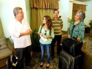 Carlos Cardoza-Orlandi (left) expresses appreciation to our translator Yulia and driver Augusto in the lobby of Saint John Hotel, as Lizzie Oquendo (right) looks on