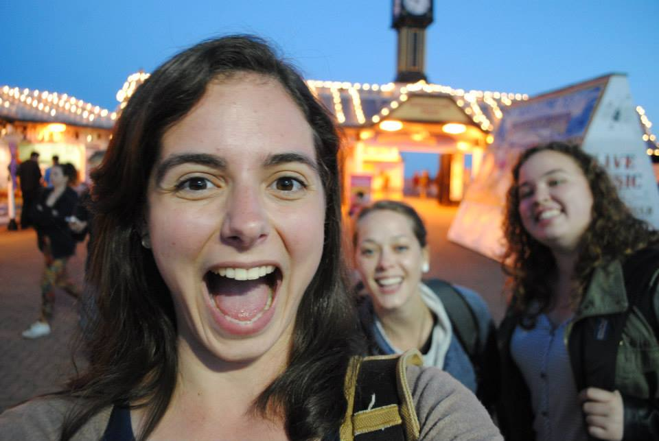 Steph, Becca and Jenna and the evening lights of Brighton Pier.
