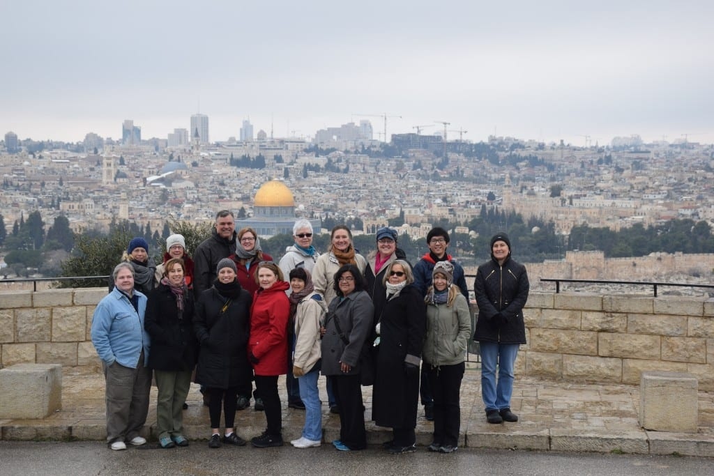 The Perkins Palestine-Israel immersion group, pictured in Jerusalem with the golden Dome of the Rock in the background.