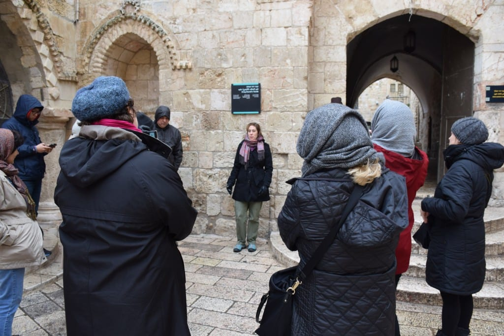 Perkins student Jen Logsdon-Kellogg recites a poem outside King David's tomb, as members of the immersion group gather around.