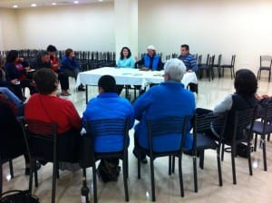 Perkins Palestine-Israel immersion group meets with UM mission personnel and Grace Tours manager.