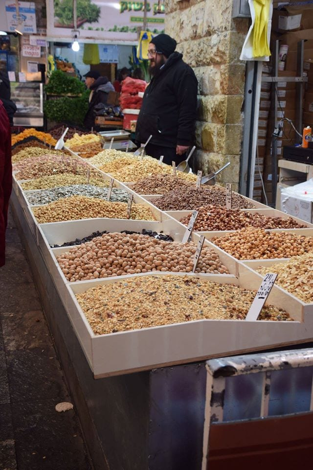 Students and alums enjoy the sights, sounds and smells of the vendors' delights at the Mahane Yahuda Market.