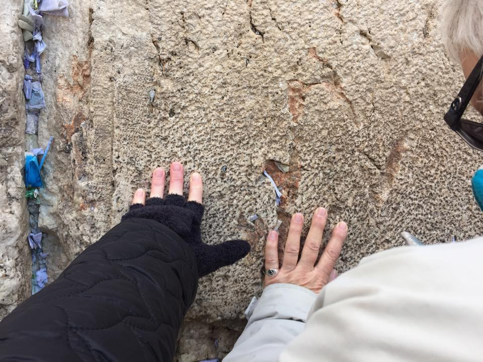 Perkins alums Carrie DeLeon and Lynette Ross touch the Western Wall as they pray.