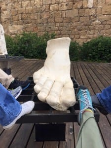 Only a foot remains of the statue of Caesar Augustus, which once stood at the harbor entry. Photo by Connie Nelson.