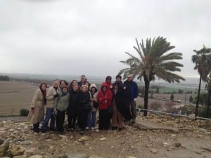 Perkins Palestine-Israel participants at Megiddo. The plain, purported site of the final battle of Armageddon, is below.