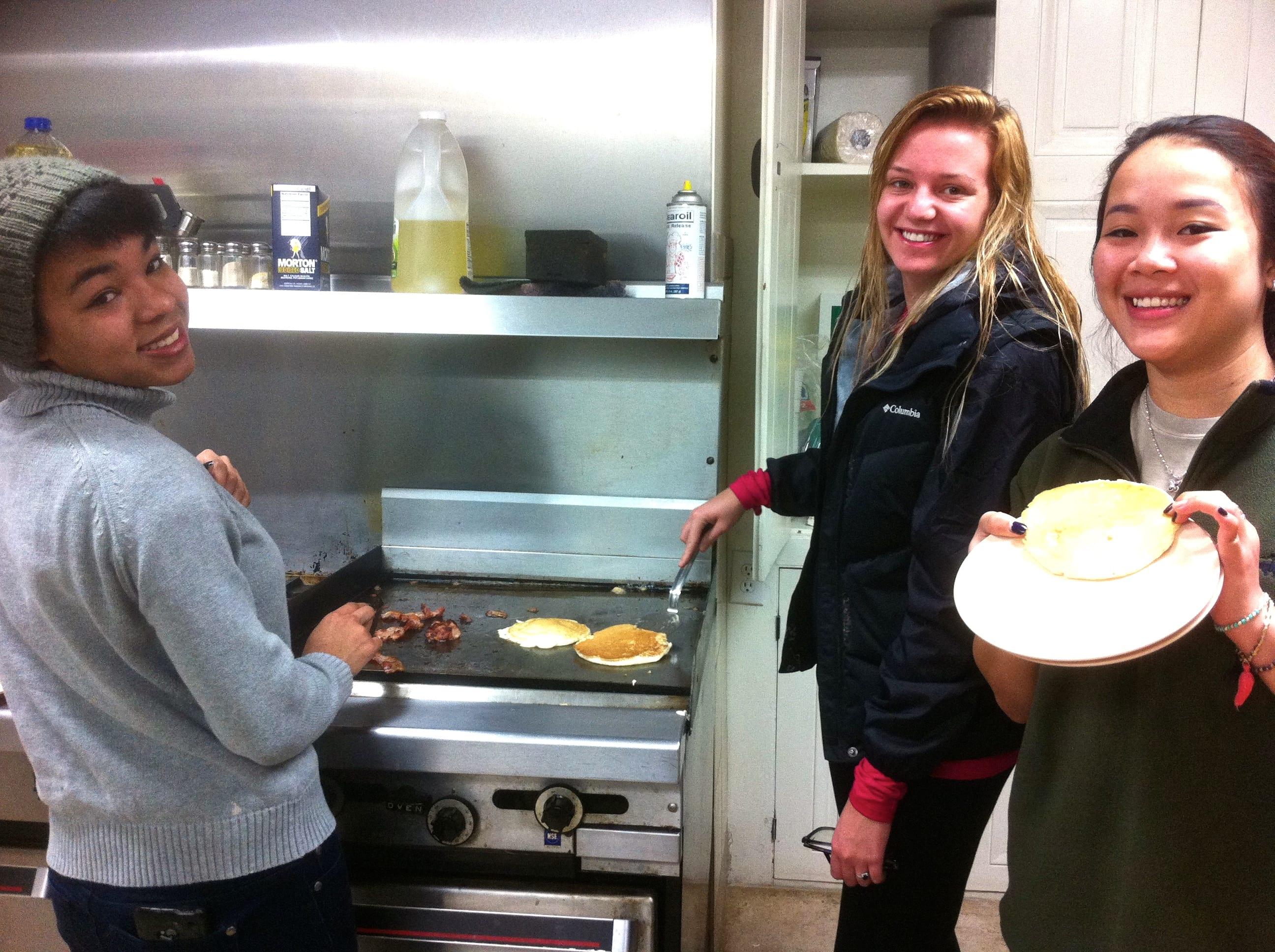 Making banana pancakes and bacon!