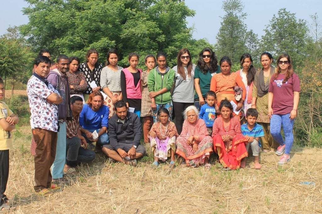 Namita stands on the far right, wearing sunglasses and a purple T-shirt.