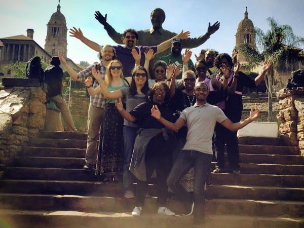 Members of the Perkins School of Theology South Africa course embrace the world with Nelson Mandela, the first president elected in a fully representative democratic election and who served from 1994-1999.