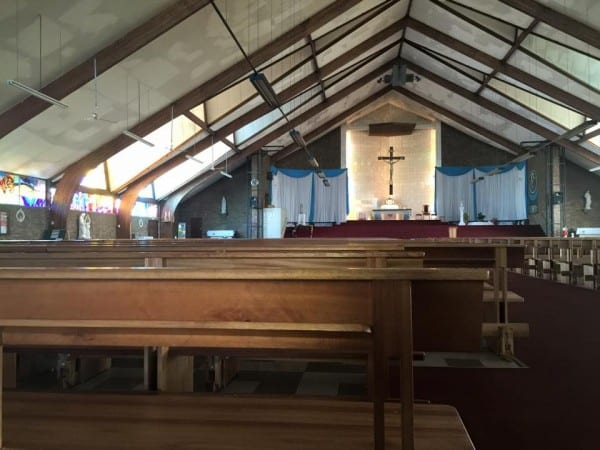 "The interior of the Regina Mundi (""Queen of the World"") Church in Soweto, home church of Archbishop Desmond Tutu.  Bullet holes remain in the ceiling as a reminder of the violence that once took place here."