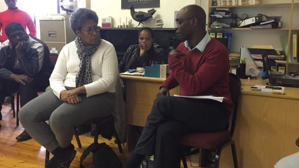 Dr. Evelyn Parker, faculty leader of the Perkins South Africa immersion course, listens to Alphonse Niyodusenga, Deputy Director, Institute for Healing of Memories.