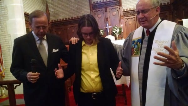 Rev. David L. Daniel (M.Div. '95) prays for Kaela Patterson Burdge, third-year Master of Divinity student at Perkins, and commits the Perkins Palestine/Israel trip team at First United Methodist Church, Ada, Okla.