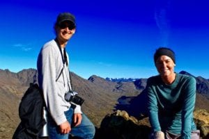 Dr. Ben Phrampus and Madie Jones at the top of Wolverine Peak with ice-capped Chugach Range in the background.