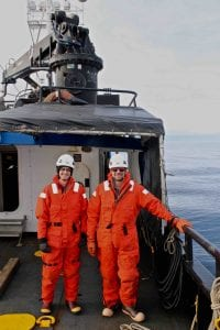 Ben Phrampus and Matt Hornbach on the deck in mustang suits before pulling the heat flow probe back onto the boat.