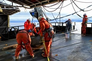 Crew and scientists getting the heat flow probe secured on deck between deployments.