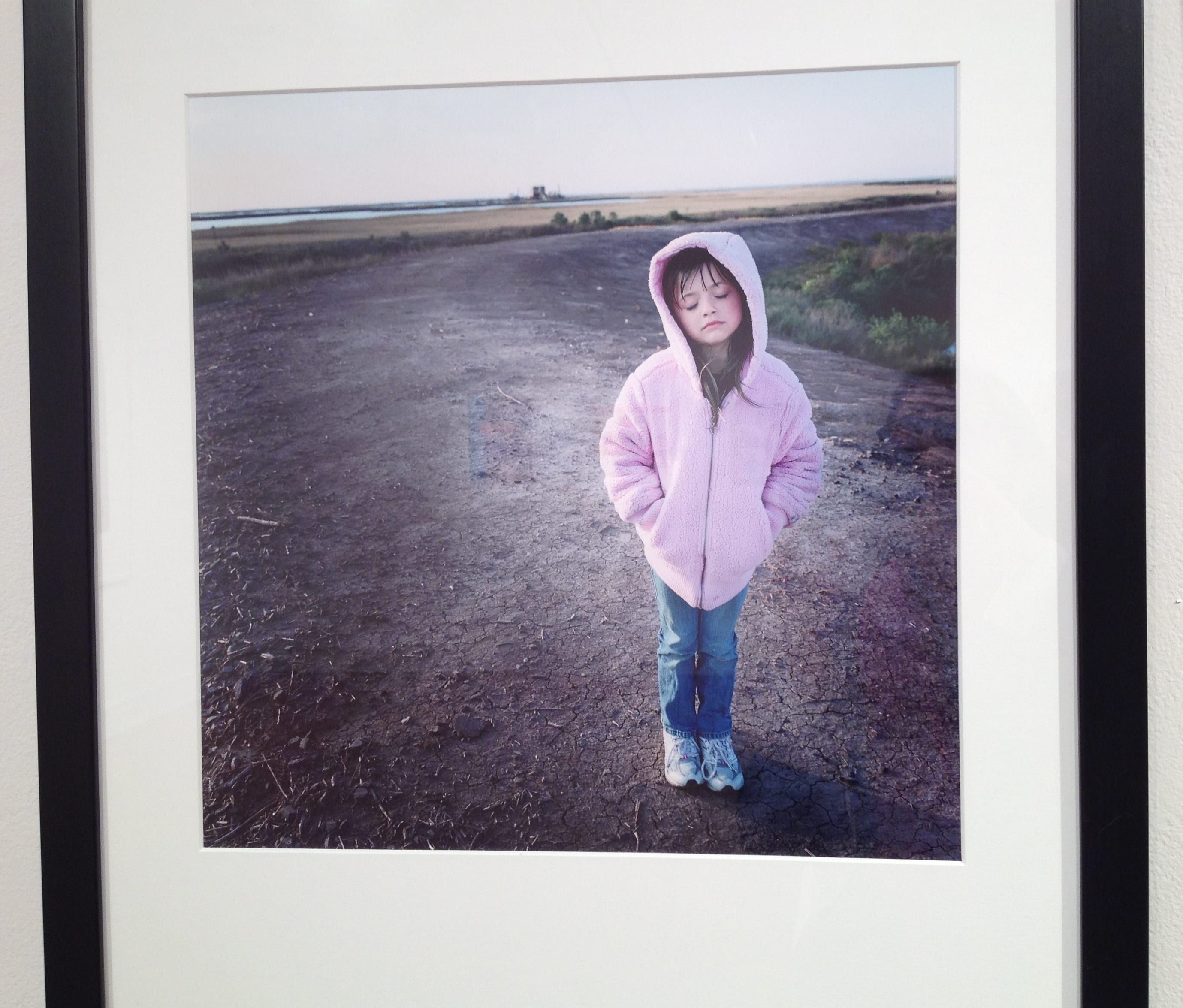 Adjunct Lecturer Kael Alford's Juliette on the Levee, 2009, one of three Alford works in the show. Archival inkjet print, 14 x 14 inches.
