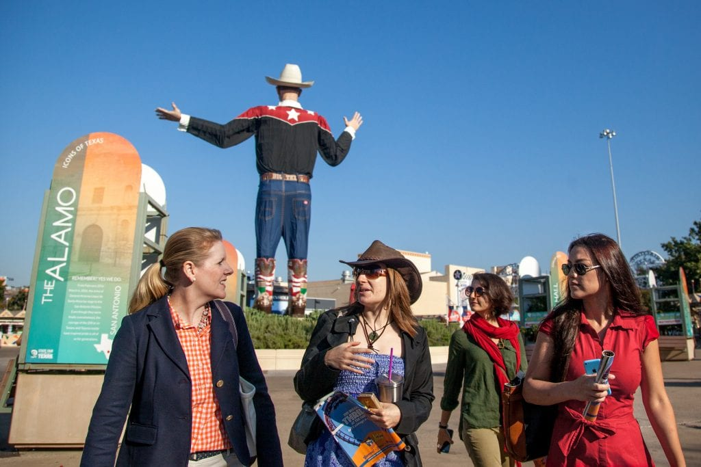 Professor Kathleen Gallagher (far left) talks with students of the International Comparative Cultural Policy class during a visit to the State Fair of Texas as part of a research project.