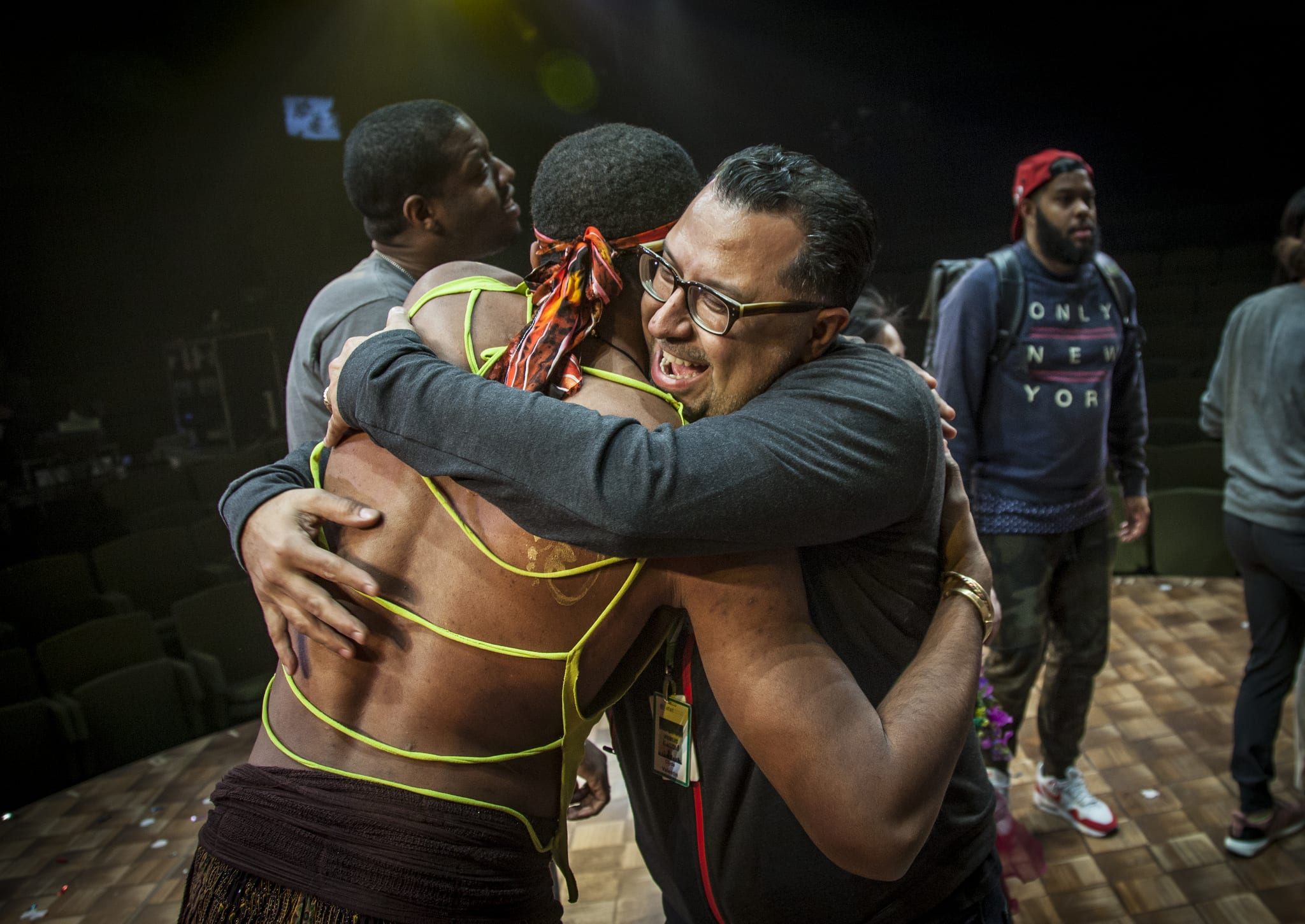 "Fearless leader of <a href=""https://www.smu.edu/Meadows/TheMovement/IgniteArtsDallas"">Ignite Arts Dallas</a>, Clyde Valentin, hugs one of the actors from<em> The Tempest</em> (Photo by Kim Leeson)"