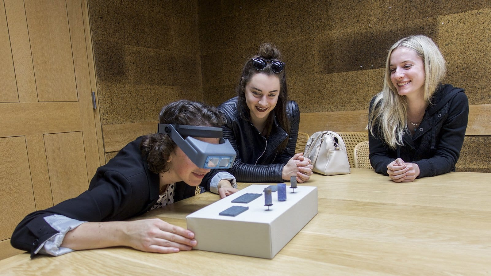 "<a href=""https://www.smu.edu/Meadows/AreasOfStudy/ArtHistory"">Art History's Dr. Langin-Hooper</a> and her Grad Seminar take behind-the-scenes look at ancient cylinder seals in vault of the Kimbell Art Museum in Fort Worth."