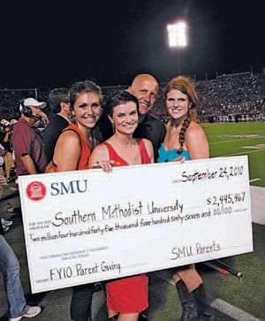 PLC Check Presentation Parent Leadership Council (PLC) Co-chairs Elisabeth Martin Armstrong '82 and William D. Armstrong '82 present a check from the PLC during halftime at the SMU-TCU football game September 24 as part of Family Weekend. They are joined by their daughters, Lindsay E. Armstrong, an SMU graduate student, and Leigh T. Armstrong '11.