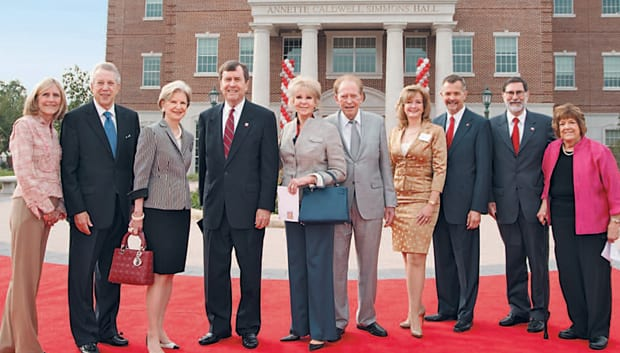 Annette Caldwell Simmons Hall forms the dramatic backdrop as some of the guests attending dedication ceremonies for the new building pause on the red carpet. (L-R) Connie Blass O'Neill '77 and Richard H. Collins '69, co-chairs of the Campaign Steering Committee for the Simmons School; Caren H. Prothro, SMU board chair; R. Gerald Turner, SMU president; Annette Caldwell Simmons '57; Harold C. Simmons; Patricia Mathes, TI Chair in Evidence-Based Education; David J. Chard, Leon Simmons Dean; Paul W. Ludden, SMU provost; and Kathy Hargrove, Simmons School associate dean for academic affairs.