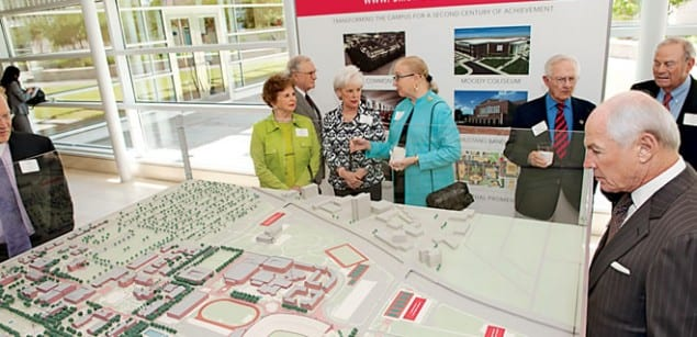 Guests examined a campus model illustrating a new phase of construction during an event to unveil The Power of Partnership: SMU Community and Impact Report. More than 400 civic and business leaders gathered at the Federal Reserve Bank of Dallas April 17 to hear President R. Gerald Turner and other speakers discuss the report's contents and the University's progress.