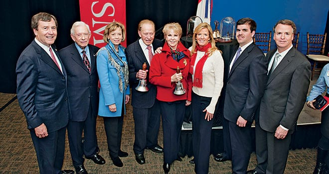 Harold Simmons and Annette Simmons '57 (center) are joined by family members and SMU President R. Gerald Turner (far left) during a ceremony February 21 announcing a gift of $25 million for SMU's Annette Caldwell Simmons School of Education and Human Development. The Simmons were presented with teachers' handbells symbolizing their commitment to education.