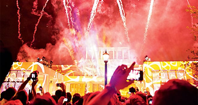"""SMU and the George W. Bush Presidential Center hosted a block party the evening of April 25 to celebrate the Bush Center's dedication. Festivities included fireworks patterned in a celebratory """"W"""" that filled the sky above the Center."""