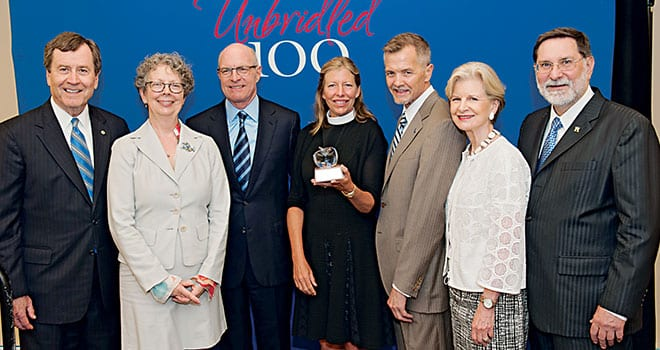 (L-R) SMU President R. Gerald Turner, Budd Center Executive Director Regina Nippert; Russell Budd; Dorothy Budd '06, holding a crystal apple presented to the Budds in recognition of their gift; Simmons School Dean David J. Chard; SMU Board Chair Caren H. Prothro; and SMU Provost Paul W. Ludden.