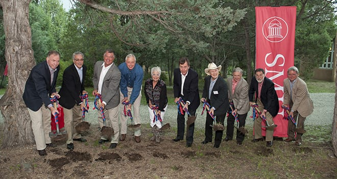 A groundbreaking ceremony was held July 18 for the new Carolyn and David Miller Campus Center at SMU-in-Taos.  (L-R) Brad E. Cheves, SMU vice president for Development and External Affairs; Rev. Stephen Rankin, SMU chaplain;  Michael Adler, executive director, SMU-in-Taos; David B. Miller '72, '73, SMU trustee; Carolyn Miller, SMU-in-Taos Executive Board member; R. Gerald Turner, SMU president; Roy C. Coffee, Jr., SMU trustee and SMU-in-Taos Executive Board member; Michael M. Boone '63, '67, SMU board chair; Paul W. Ludden, SMU provost; and Harold W. Stanley, SMU associate provost.