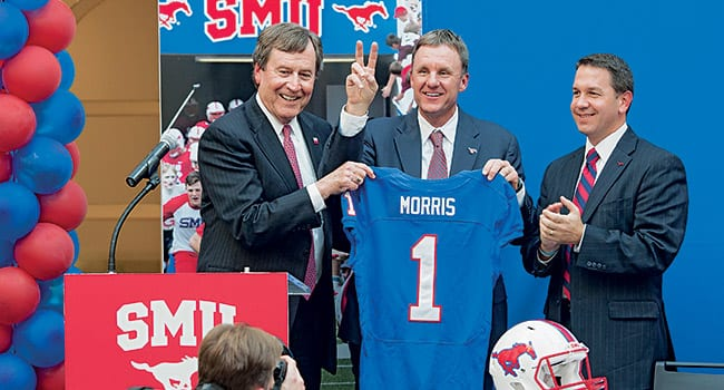 SMU named Chad Morris, who served as offensive coordinator at Clemson University and was also a Texas high school football coach, as the new Mustang Head Football Coach in December. During his four seasons at Clemson, Morris helped the Tigers achieve a 41-11 record and earn the 2011 ACC Championship and four bowl berths, including two BCS Orange Bowl appearances. Previously Morris served as a head coach at various Texas high schools for 16 years. (L–R) SMU President R. Gerald Turner, Chad Morris and SMU Athletic Director Rick Hart.