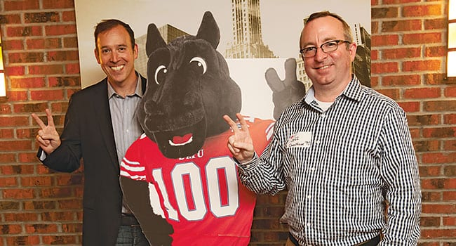George P. Yedinak '97 (left), a member of The Second Century Campaign Steering Committee for Chicago, and Jeff Cheatham '95 show their Mustang spirit as they flank a cutout of Peruna during the World Changers Spotlight in Chicago on July 28. The gathering at the Gage Restaurant on Michigan Avenue featured a presentation by Samuel S. Holland, the new Algur H. Meadows Dean of the Meadows School of the Arts.