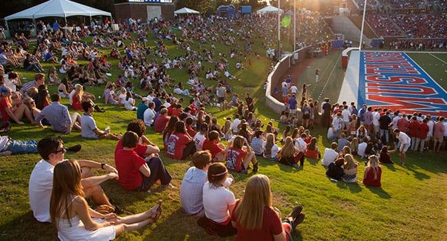 Spectators enjoy the SMU vs. James Madison University football game.