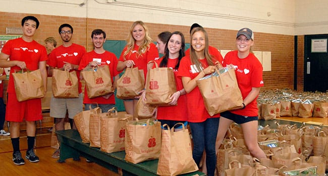 Student volunteers help with the Brighter Bites community pantry as part of Centennial Stampede of Service.