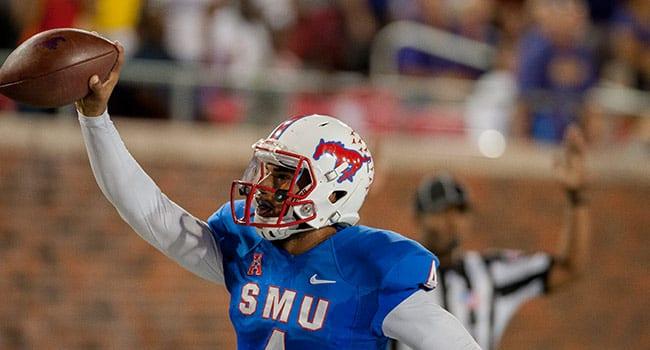 Mustang quarterback Matt Davis '17 in action against the James Madison University Dukes.