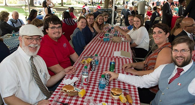 Members of the SMU family come together for a community picnic on the Clements Hall lawn following the centennial commemoration ceremony.
