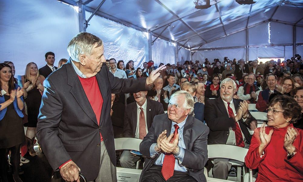 """George """"Coach Mac"""" McMillion '55 is recognized by the audience at the groundbreaking for the Robson-Lindley Aquatics Center and Barr-McMillion Natatorium."""