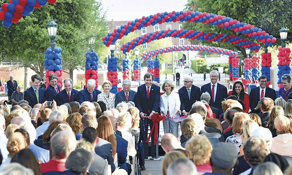 Leaders of The Second Century Campaign and members of the Crain family prepare to cut the ribbon opening the Crain Family Centennial Promenade. (L-R) Lawson M. Crain '11; B.W. Crain, IV '05; Brad E. Cheves, SMU vice president for Development and External Affairs; Ray L. Hunt '65, co-chair; Caren H. Prothro, co-chair; Michael M. Boone '63, '67, co-chair; R. Gerald Turner, SMU president; Gail Turner; Gerald J. Ford '66, '69, convening co-chair; Carl Sewell '66, co-chair; Diana Cates '18, Tower Scholar; Duncan MacFarlane, SMU Bobby B. Lyle Centennial Chair in Engineering Entrepreneurship; Julie Wiksten '78, '92, SMU associate vice president for operational excellence.