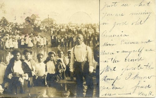 Detail of African-American men and women at a baptism, postcard, 1908.