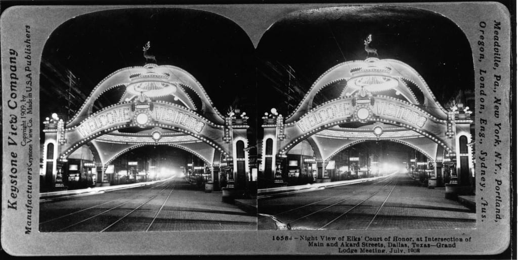 Stereograph souvenir image of the Elks' Arch illuminated at night, 1908