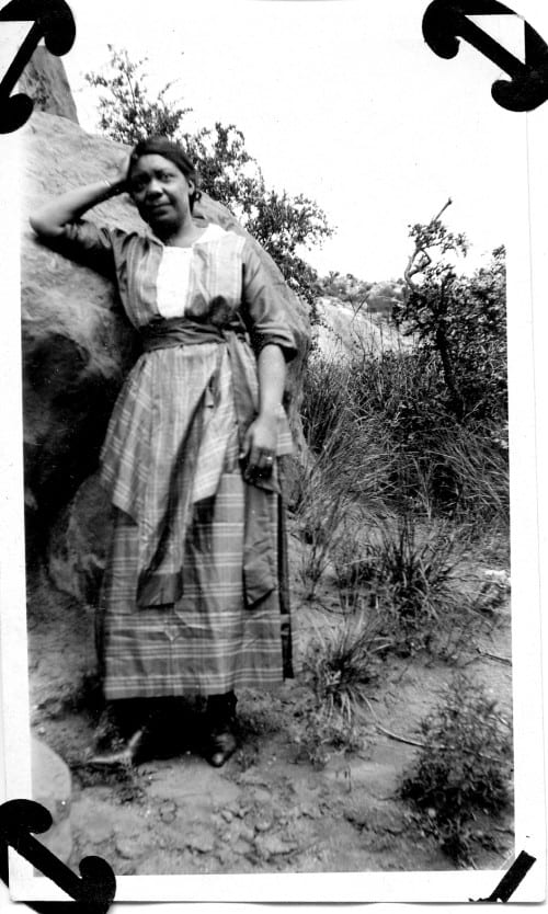 An unnamed African-American woman photographed leaning on a rock in Dallas, 1919