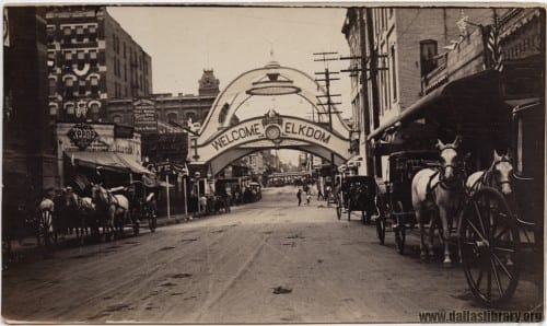 Horse and carriage traffic on Main in front of Elks Arch, ca. 1908